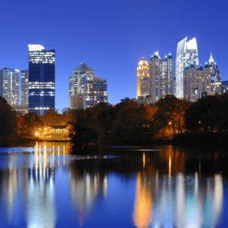 Shot of Atlanta's Skyline at night with lights reflecting of a lake