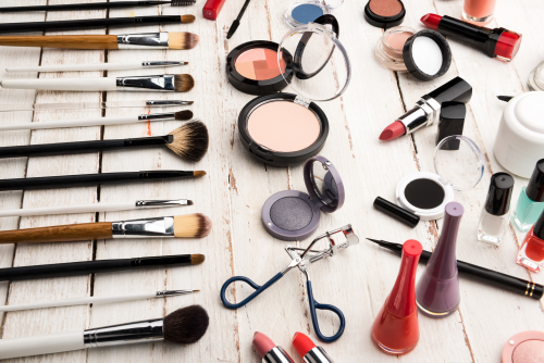 Makeup collection on white boards
